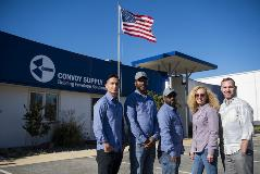 Convoy staff outside of our Maryland branch with the US flag flying.